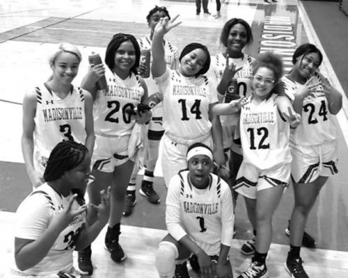 Members of the Madisonville women's basketball team pose together at MHS Friday after defeating Connally, their second straight win in district play. COURTESY PHOTO
