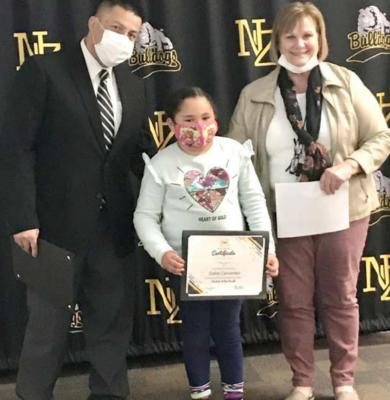 North Zulch ISD Student of the Month Delila Cervantes poses with High School Principal Janie Pope and Assistant Principal Pete Martinez.