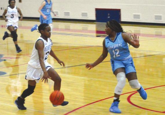 Daiona Johnson drives to the basket during a 2019 home game. Campbell Atkins