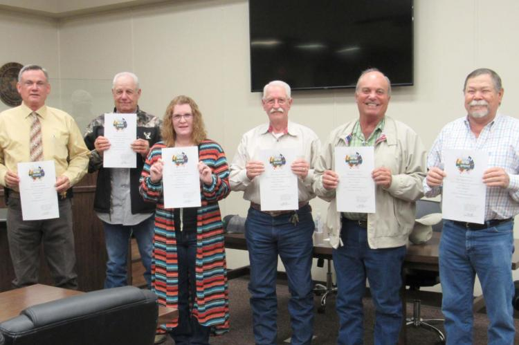 County officials (from left) Sheriff Bobby Adams, Constable Charles Turner, Tax Accessor Collector Karen Lane, Constable Jim Jackson, Commissioner Carl Cannon and Commissioner Ricky Driskell pose together at the courthouse Friday following their oath. CAMPBELL ATKINS